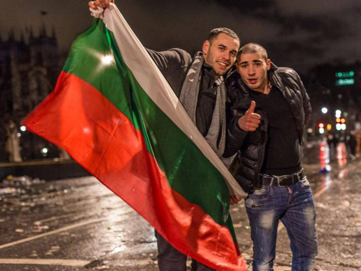 Two Bulgarians in London yesterday, the day restrictions were lifted allowing their countrymen to live and work in Britain