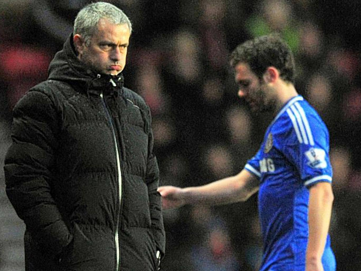 Juan Mata walks past Jose Mourinho after being substituted