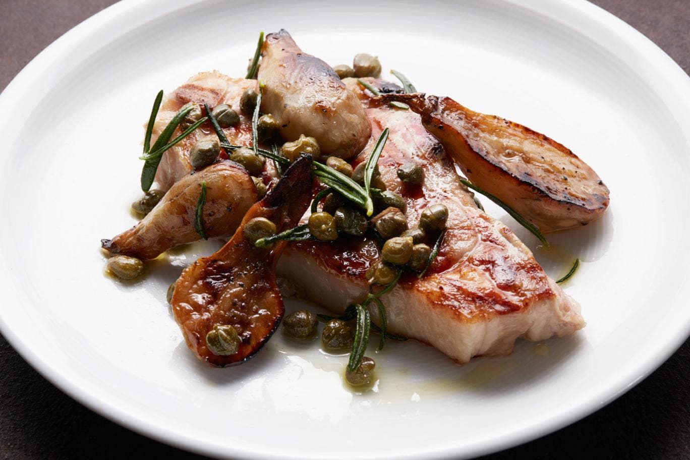 Grilled veal chop with Jerusalem artichokes, capers and rosemary