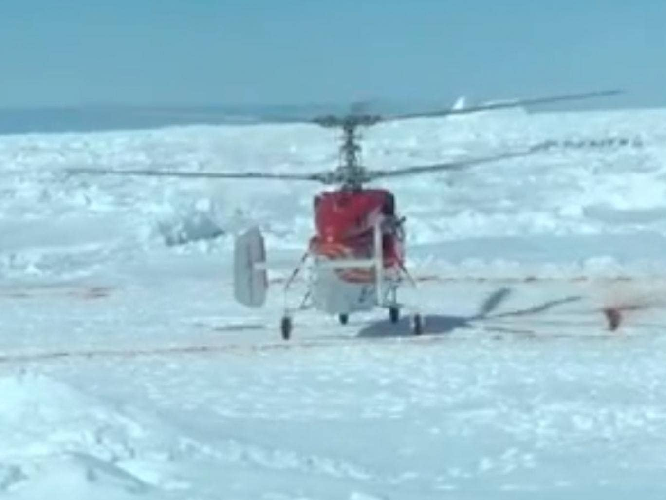 A helicopter from a nearby Chinese icebreaker lands near the Akademik Shokalskiy