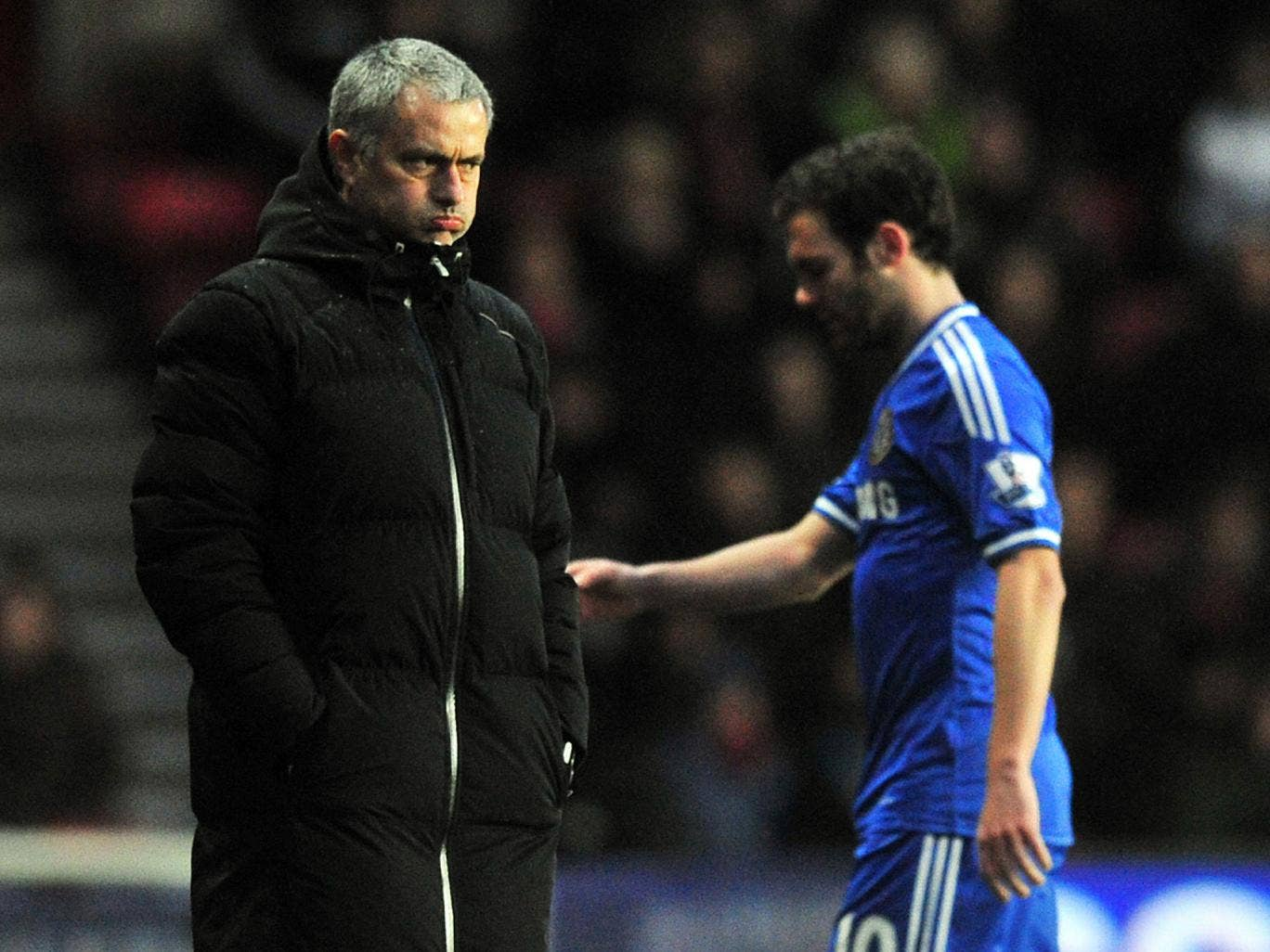 Jose Mourinho and Juan Mata avoid making eye contact after the latter is substituted during the 3-0 victory over Southampton