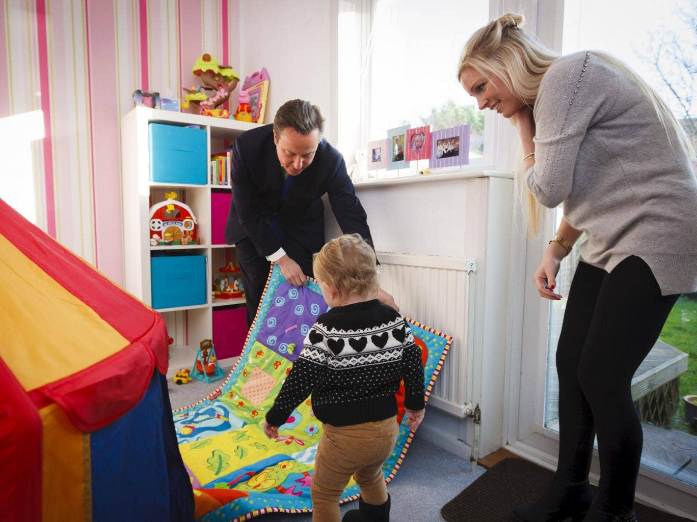 Prime Minister David Cameron with Sharon Ray and her daughter Maisie, 2, during a visit to her home in Southampton, Hampshire which she has bought through the government's Help to Buy scheme