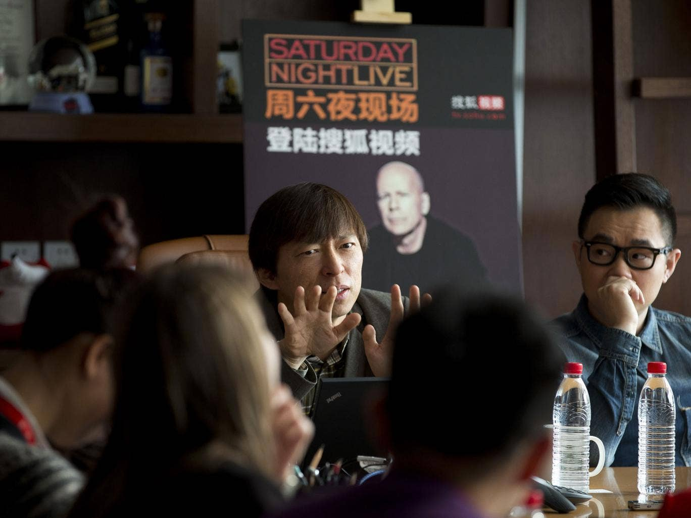 Charles Zhang speaks to journalists during a press conference in Beijing