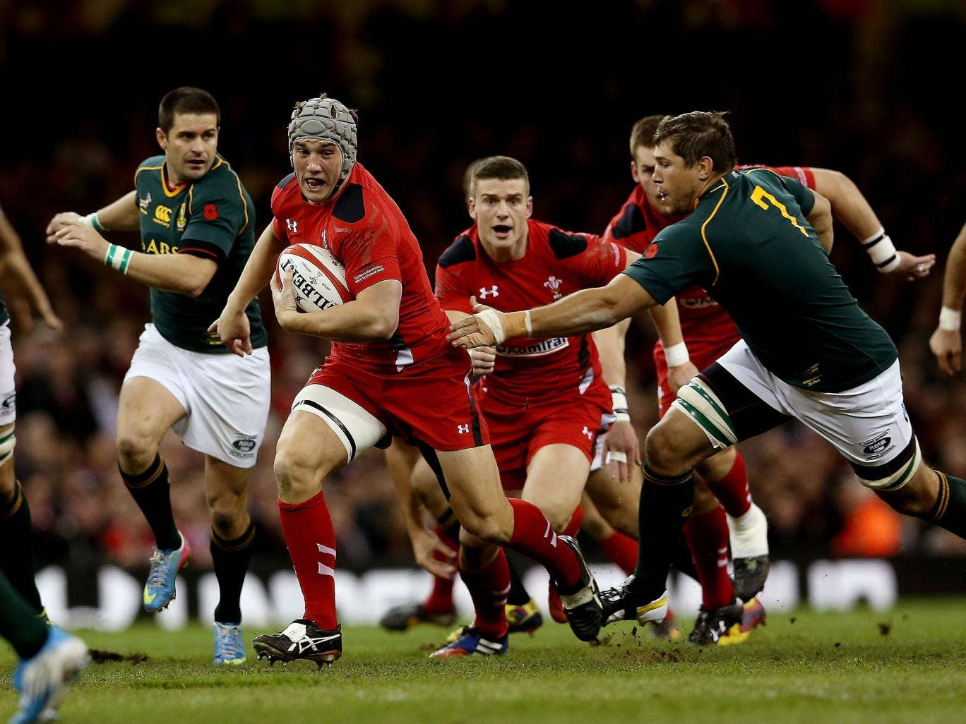 Wales centre Jonathan Davies, second left, is set to miss the Six Nations