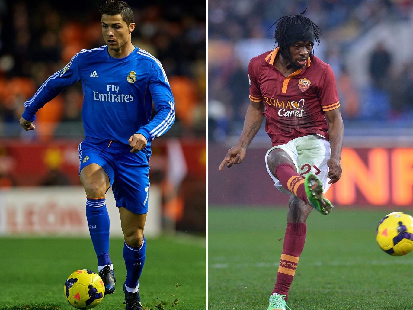 Real Madrid's Cristiano Ronaldo (left) and Gervinho of Roma