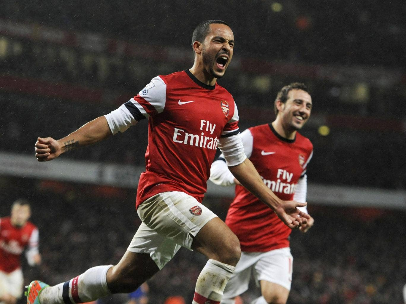 Arsenal's Theo Walcott celebrates his goal against Cardiff