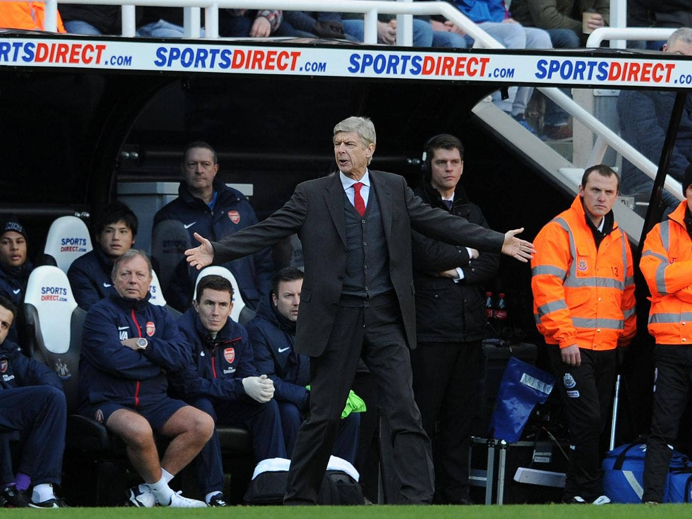 Arsene Wenger gestures on the sidelines during Arsenal's win over Newcastle