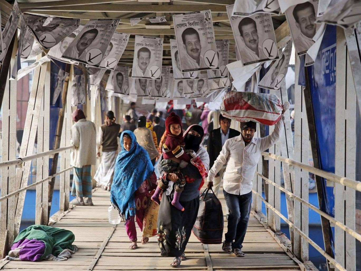 Election day: Dhaka's ferry terminal was festooned with campaign leaflets