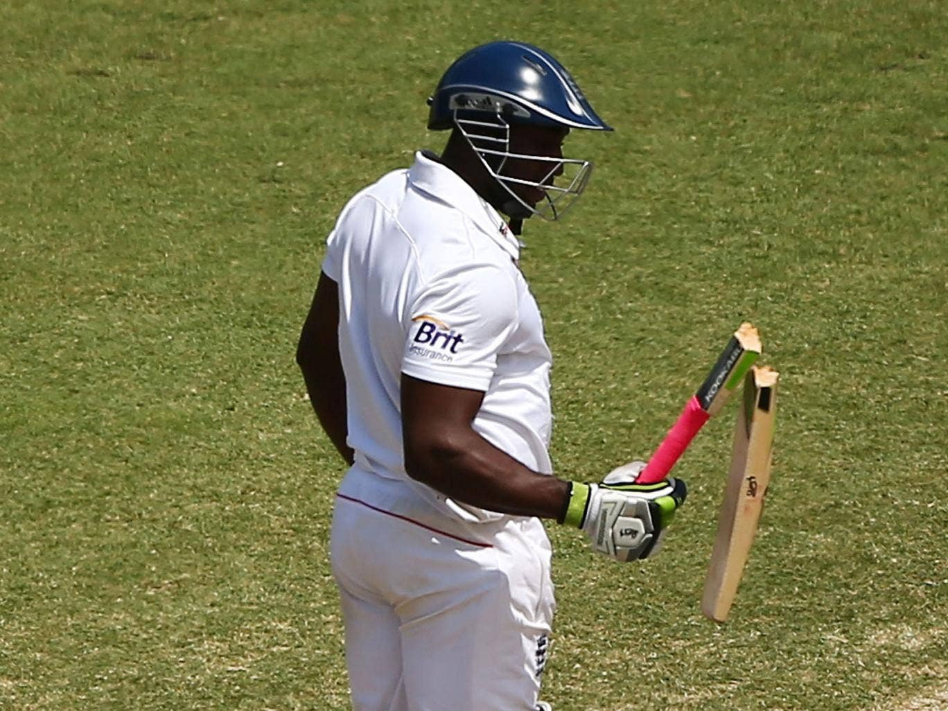 Michael Carberry of England has his bat broken by a delivery from Ryan Harris of Australia during day three of the Fifth Ashes Test
