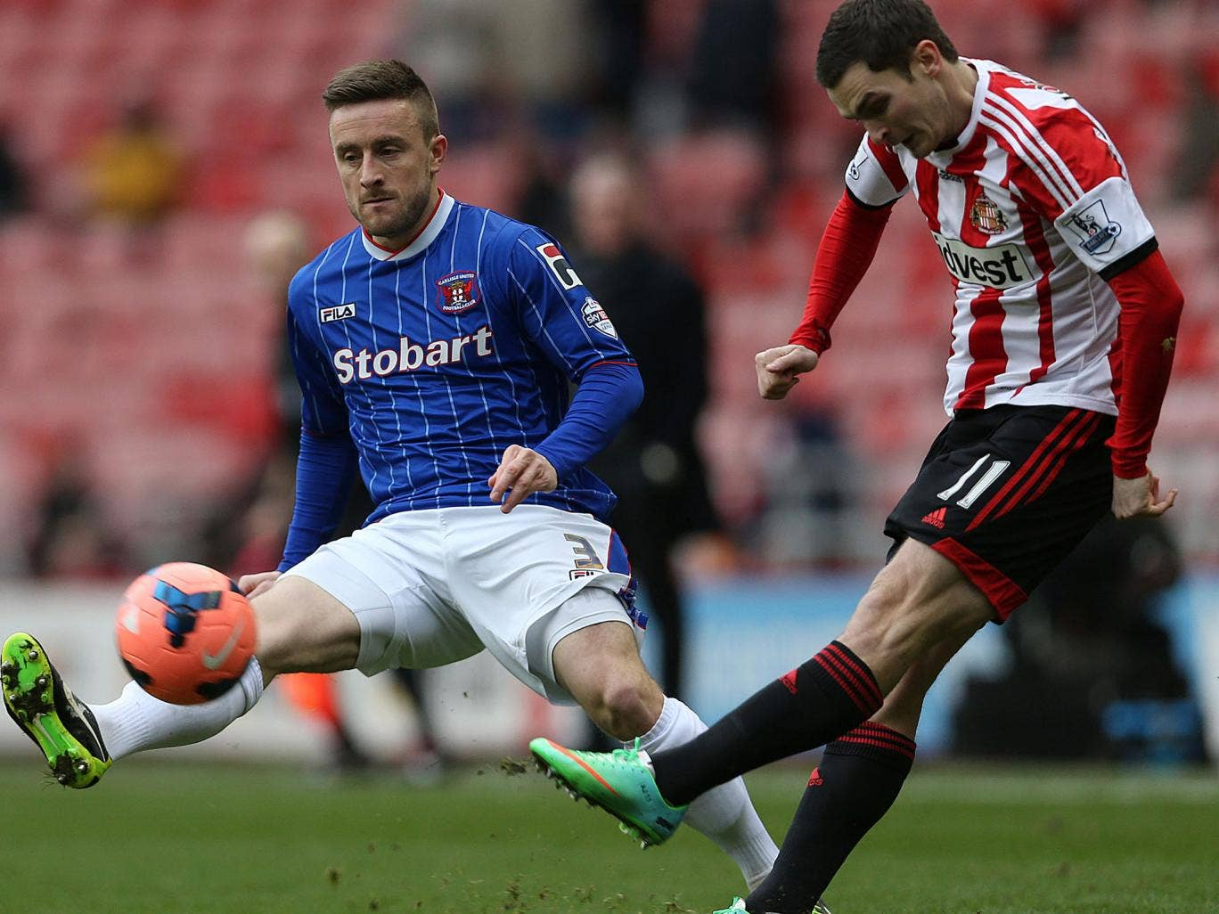 Carlisle United's Matty Robson (left) vies with Sunderland's  Adam Johnson in the FA Cup clash on Sunday