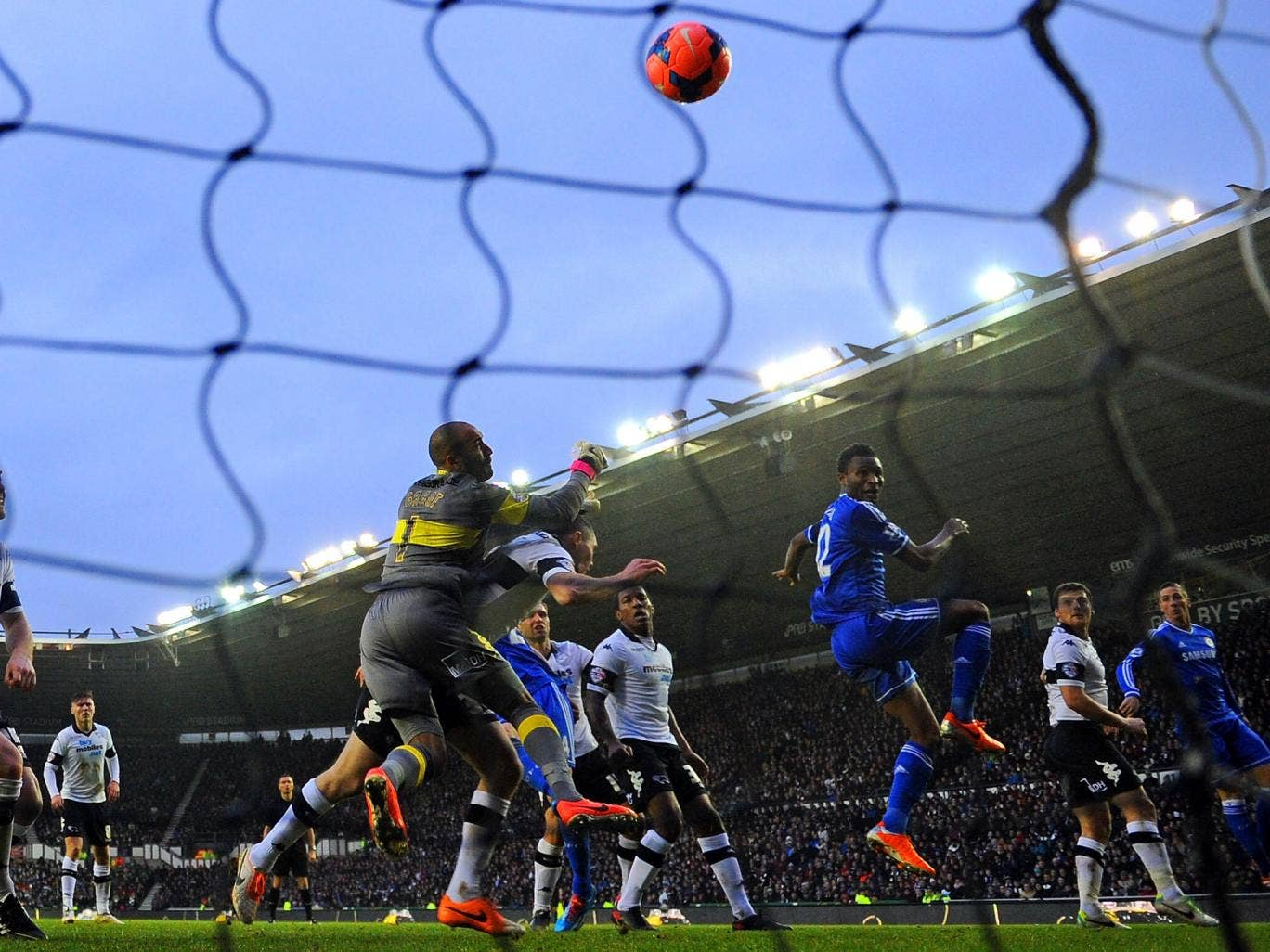 John Obi Mikel heads in Chelsea's opening goal against Derby on Sunday