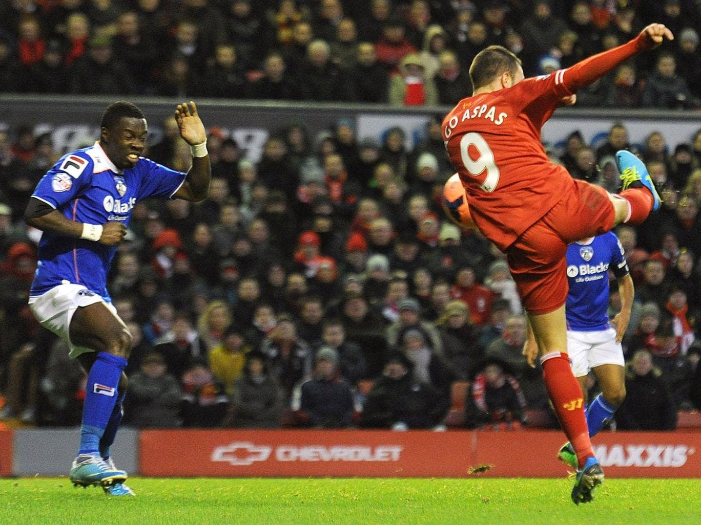 Liverpool's Iago Aspas scores the first goal during their FA Cup Third Round match against Oldham Athletic