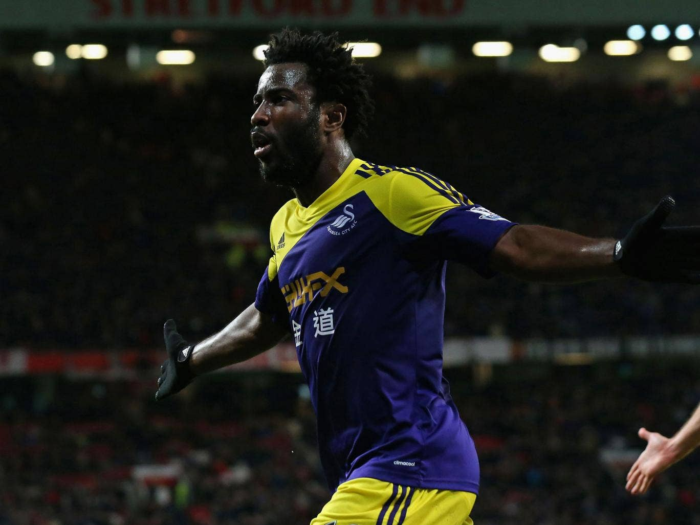 Wilfried Bony celebrates his late header at Old Trafford