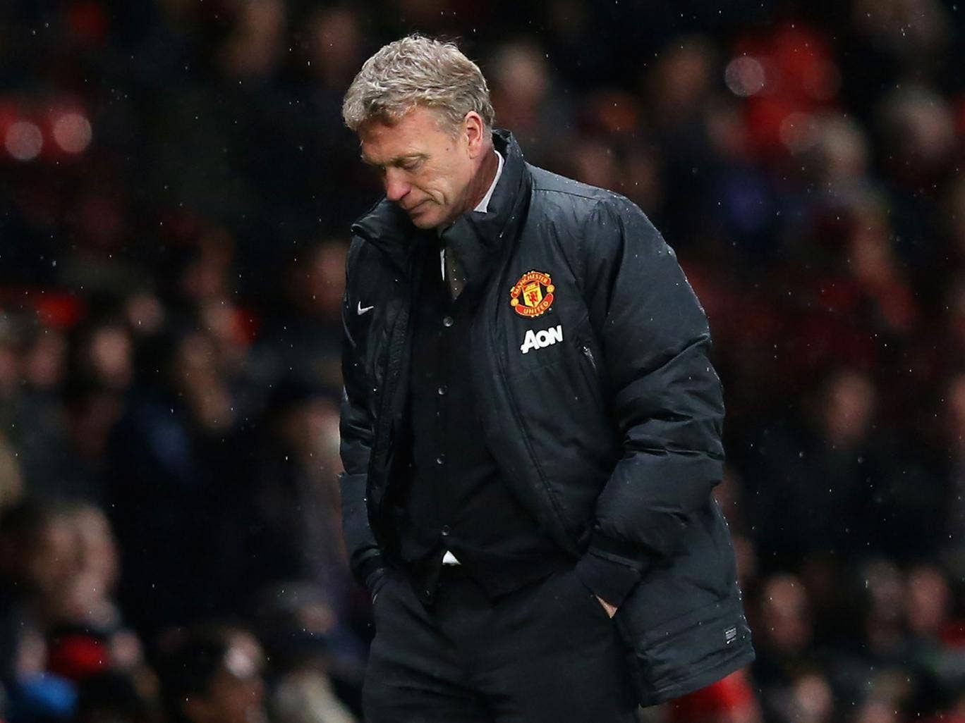 Manchester United manager David Moyes looks on in downbeat fashion during his club's 2-1 defeat by Swansea