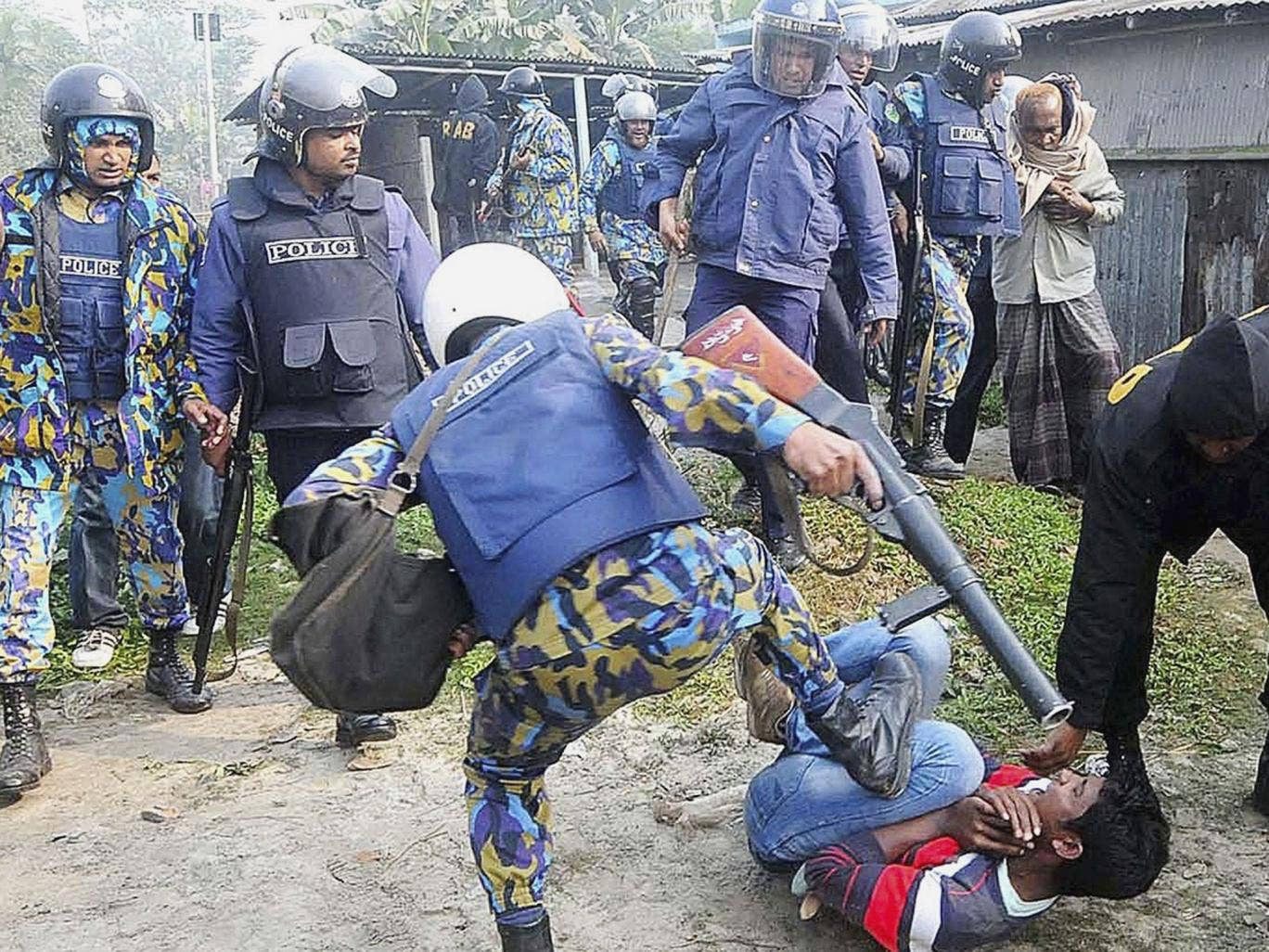 A clash between police and protesters after a crowd attacked polling booths in Bogra in the north
