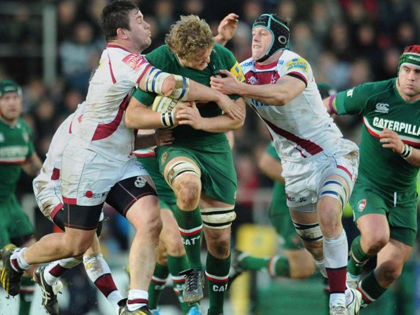 Leicester Tigers' Jamie Gibson is tackled by Sale Sharks' Marc Jones