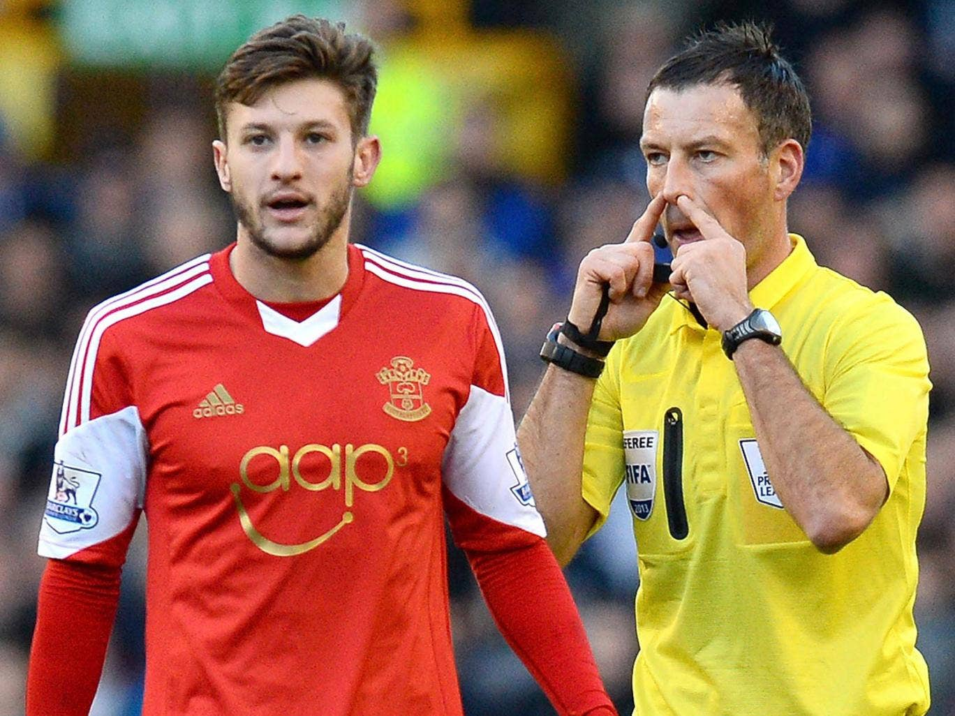 Mark Clattenburg, right, and Adam Lallana, left, the men at the centre of a farcical controversy