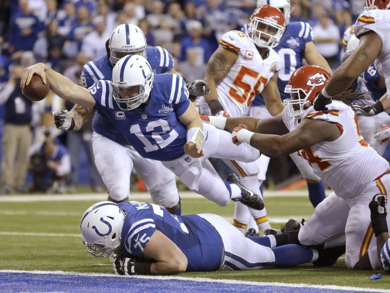Indianapolis Colts quarterback Andrew Luck (12) dives for a touchdown
