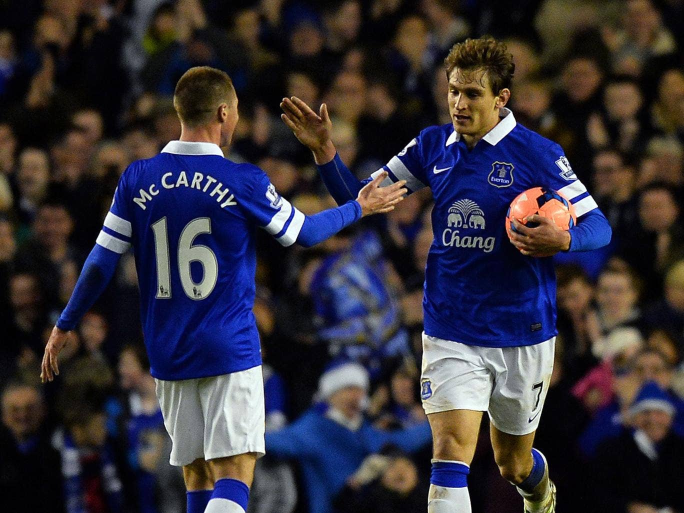 Everton striker Nikica Jelavic celebrates with James McCarthy after scoring in the 4-0 FA Cup win over QPR