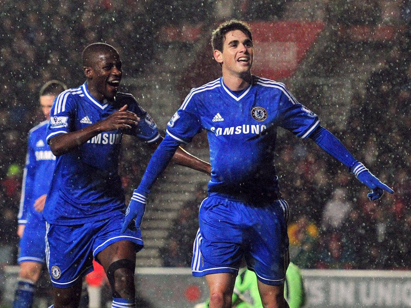 Ramires and Oscar celebrate after the latter scores Chelsea's second goal in the 2-0 win over Derby County