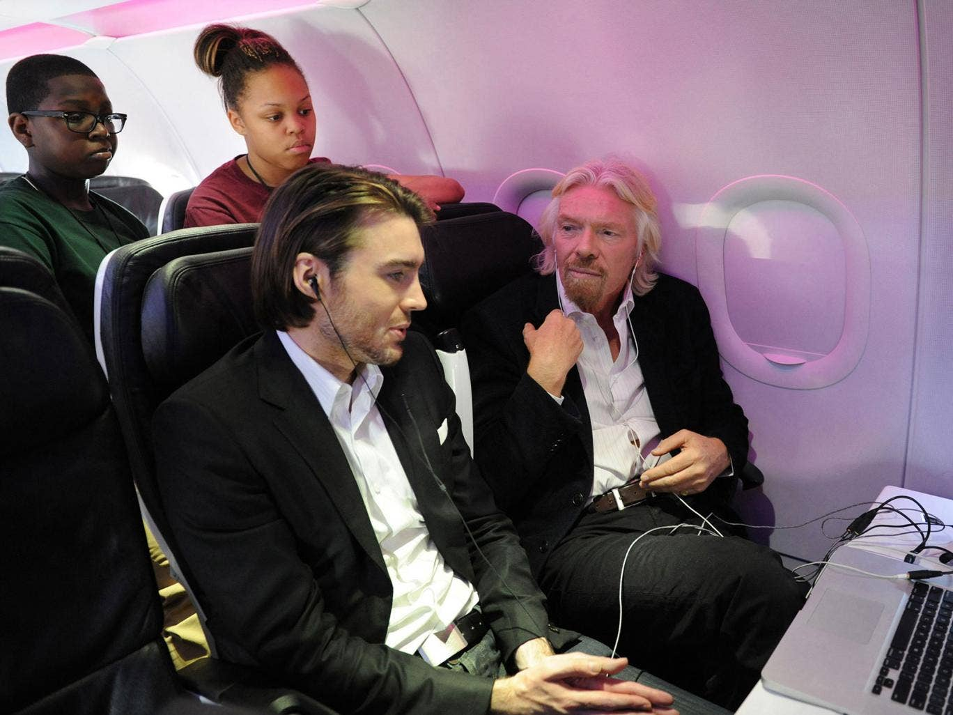 Founder Sir Richard Branson (R) celebrates the launch of its new service to Newark, New Jersey from San Francisco and Los Angeles with Mashable CEO & Founder Pete Cashmore onboard aircraft at Newark Liberty International Airport at Newark, New Jersey