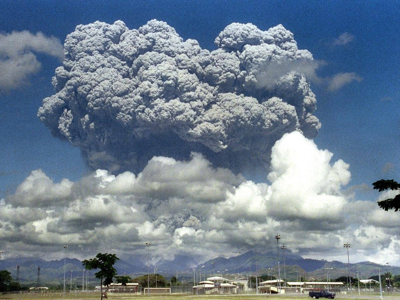 A giant cloud of volcanic debris rises some 20km above Mount Pinatubo in the Philippines in June 1991