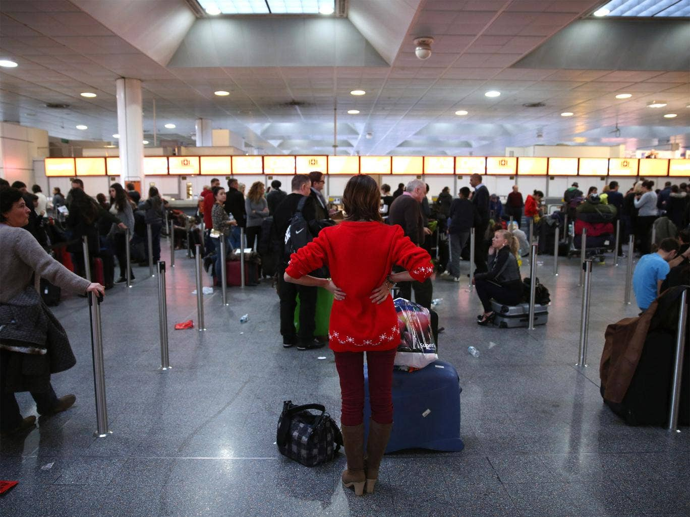 Frustrated passengers wait in the departure hall of Gatwick's North Terminal on Christmas Eve