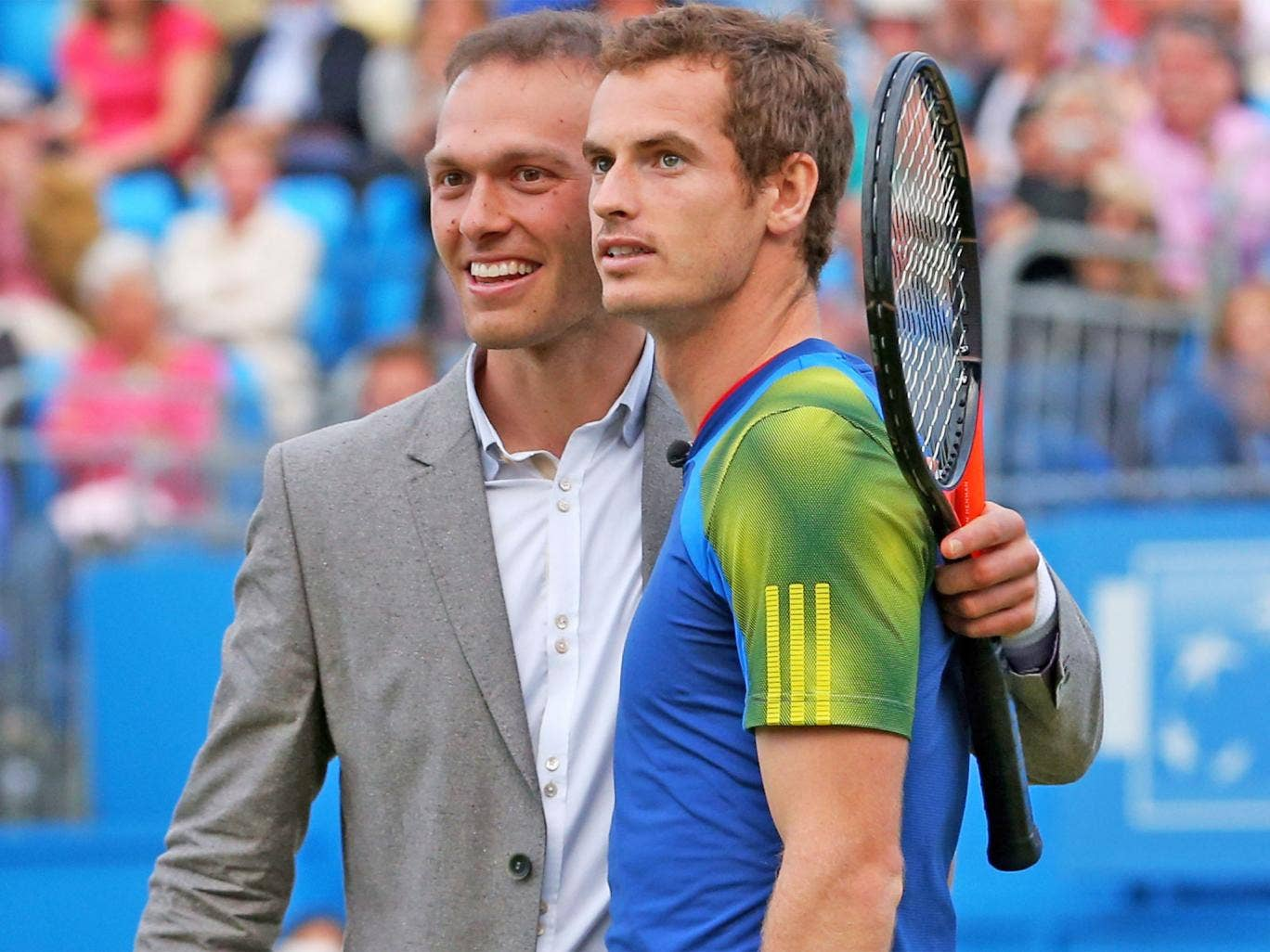 Ross Hutchins (left) hugs Andy Murray after a tennis match in aid of a cancer charity