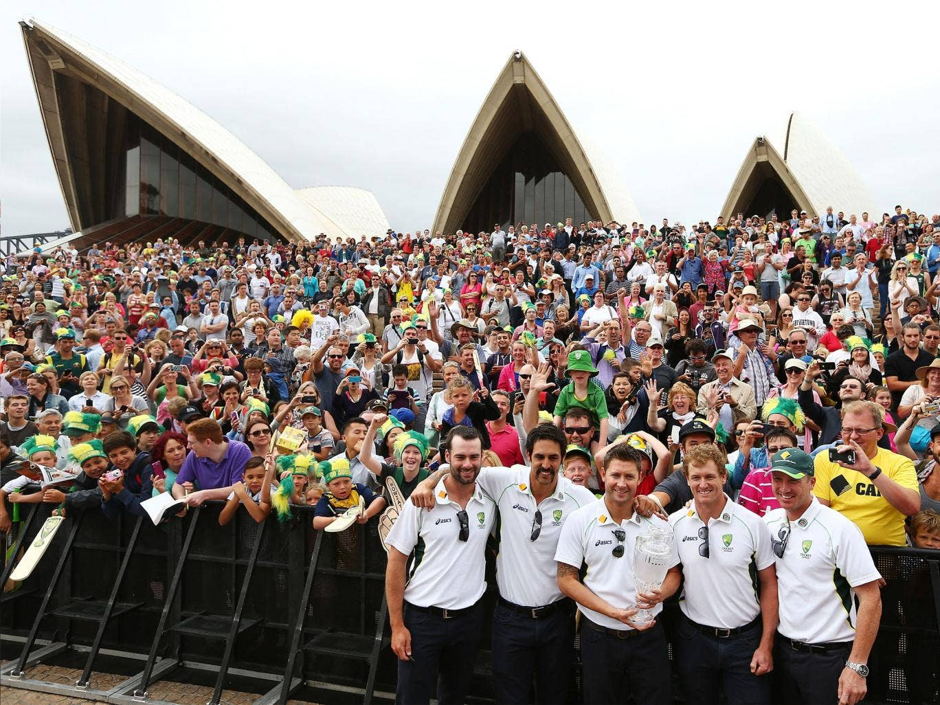 Australia's Alex Doolan, Mitchell Johnson, Michael Clarke, George Bailey and Brad Haddin celebrate their Ashes whitewash with the public in front of the Sydney Opera House