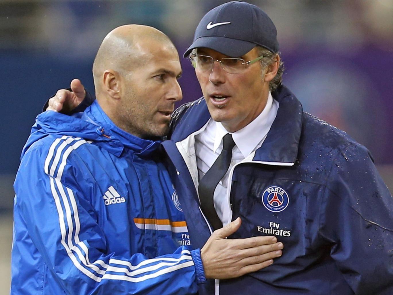 Real Madrid's sporting director Zinedine Zidane (left) held the fort when Jose Mourinho left