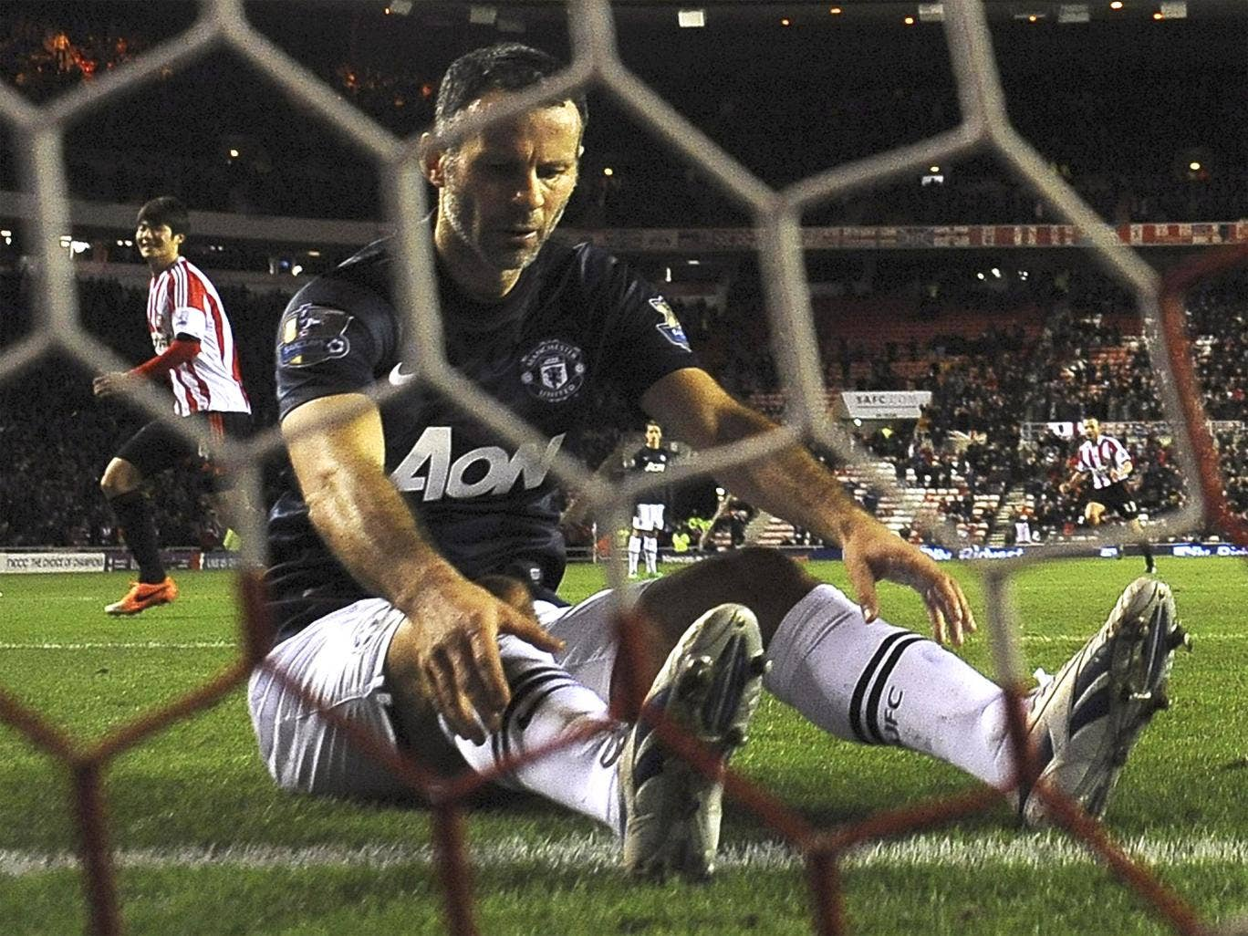 Ryan Giggs looks downcast after scoring an own goal in Manchester United's defeat against Sunderland at the Stadium of Light