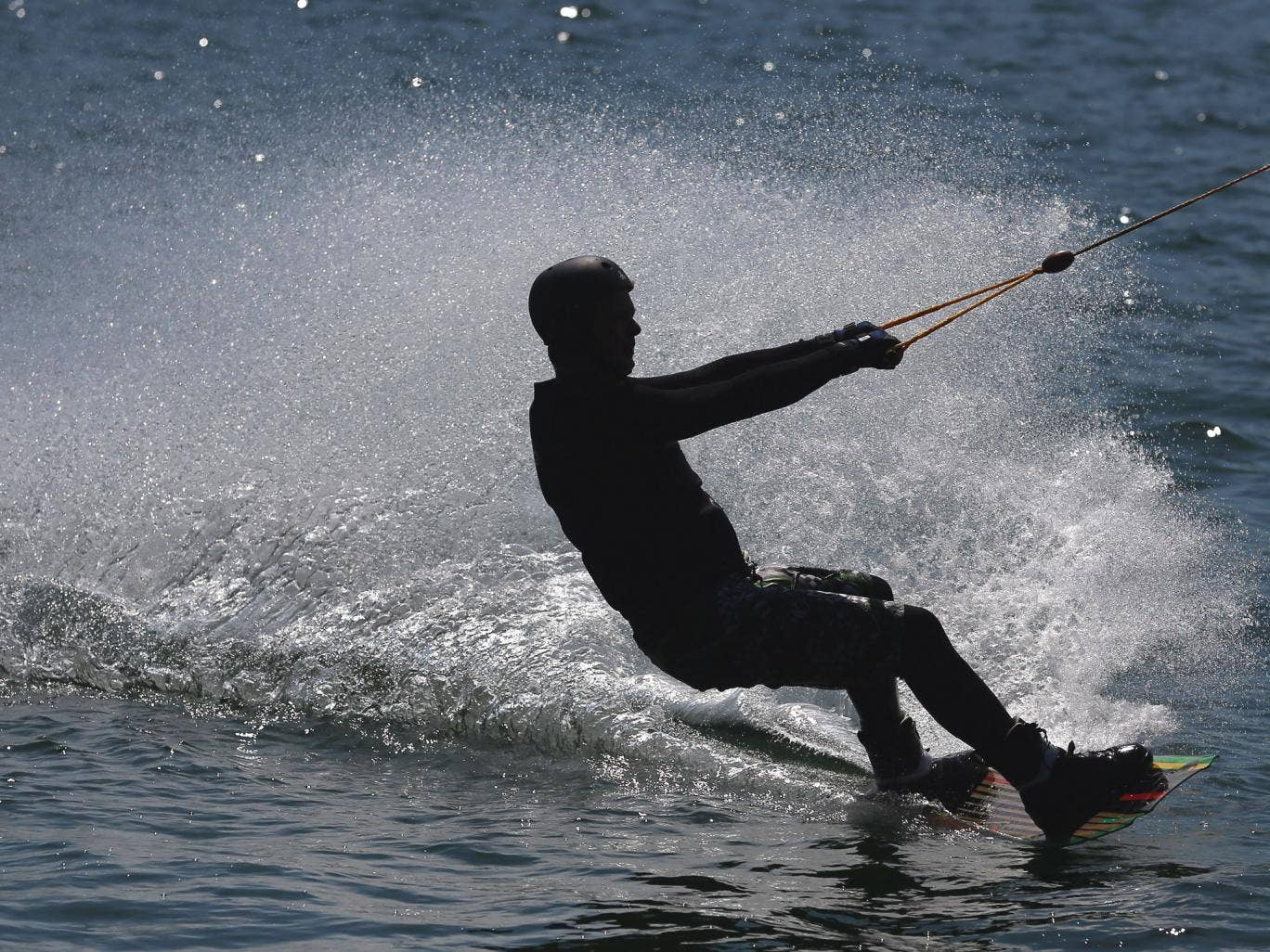 LANGENFELD, GERMANY - MAY 05: A Wakeboarder rides on his board at Waterski Langenfeld on May 5, 2013 in Langenfeld, Germany.