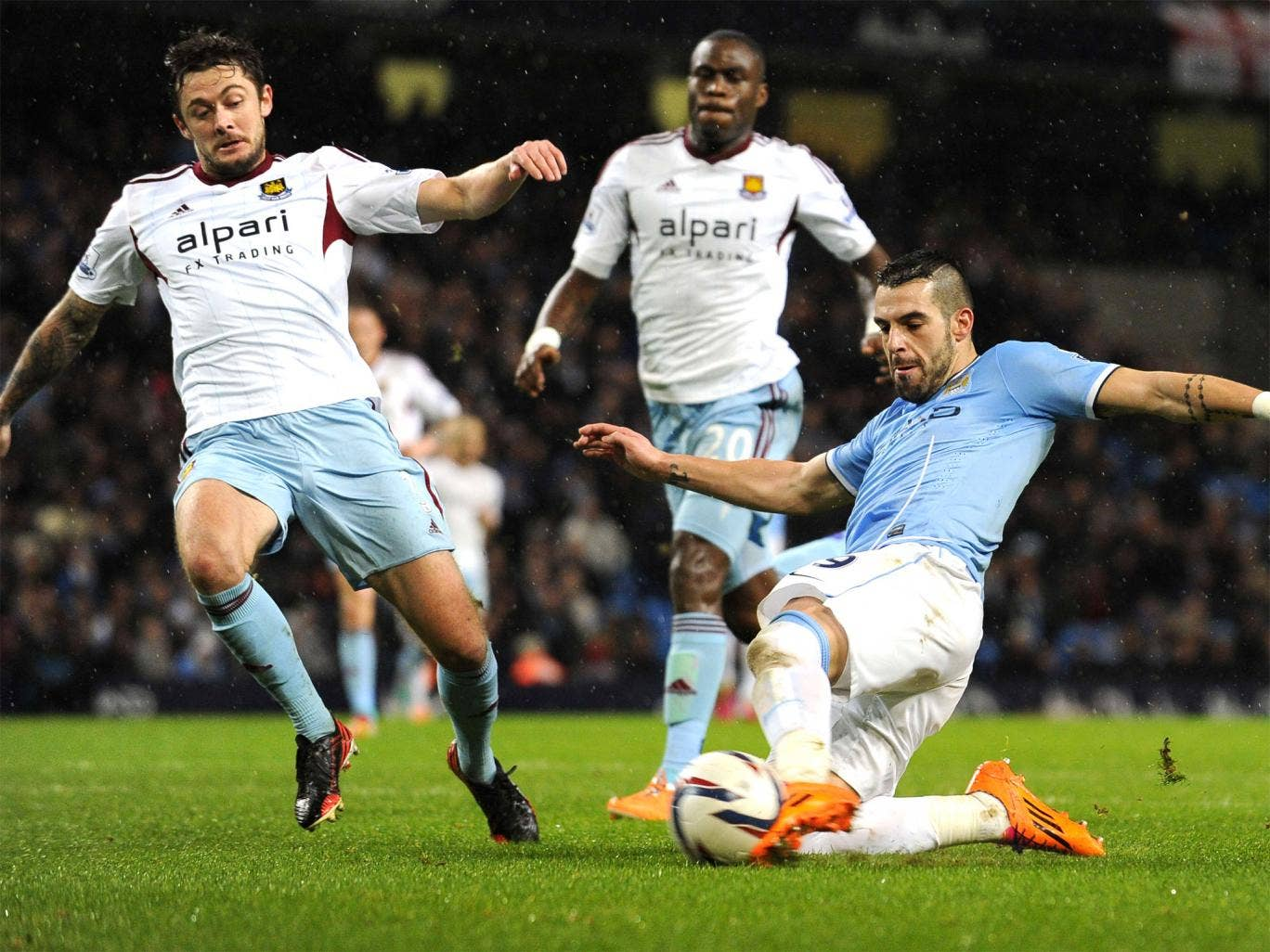 Alvaro Negredo slides in to score his second goal