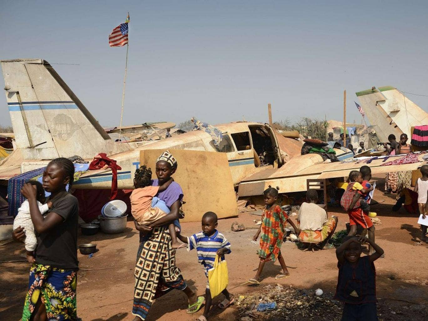 Displaced people in an aero-club area near Mpoko Bangui airport where 100,000 people have fled
