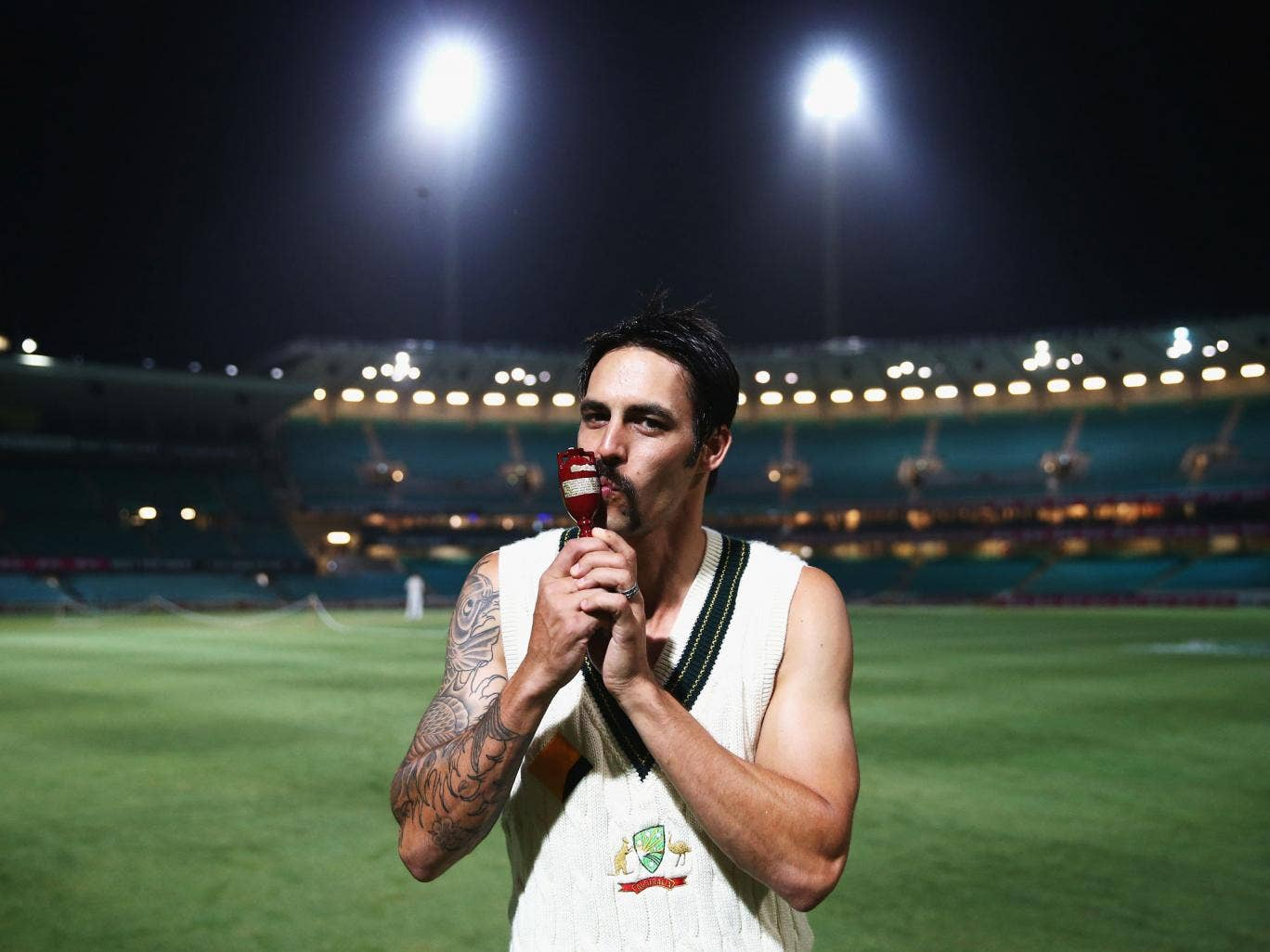 Mitchell Johnson celebrates with the Ashes Urn after the 5-0 whitewash over England