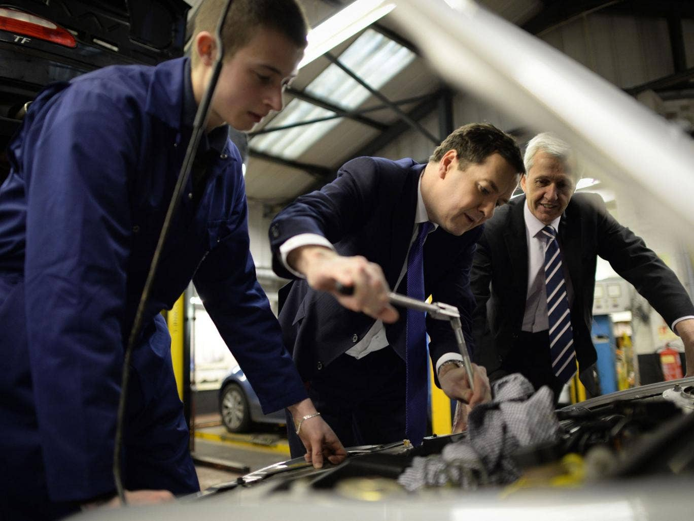 Chancellor George Osborne shows off his mechanical abilities during a visit to a garage in Enfield, north London