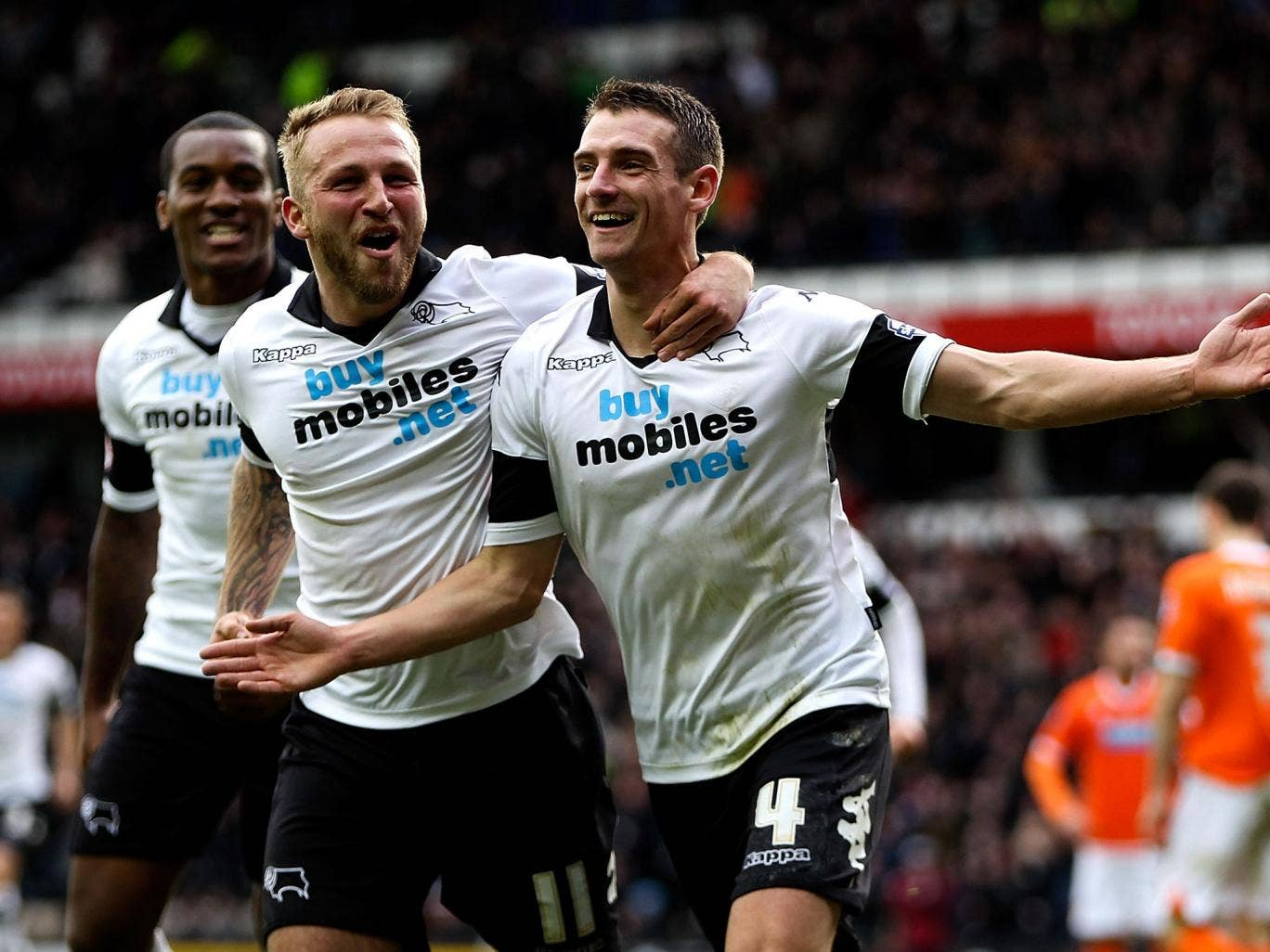 Craig Bryson, right, celebrates scoring for Derby