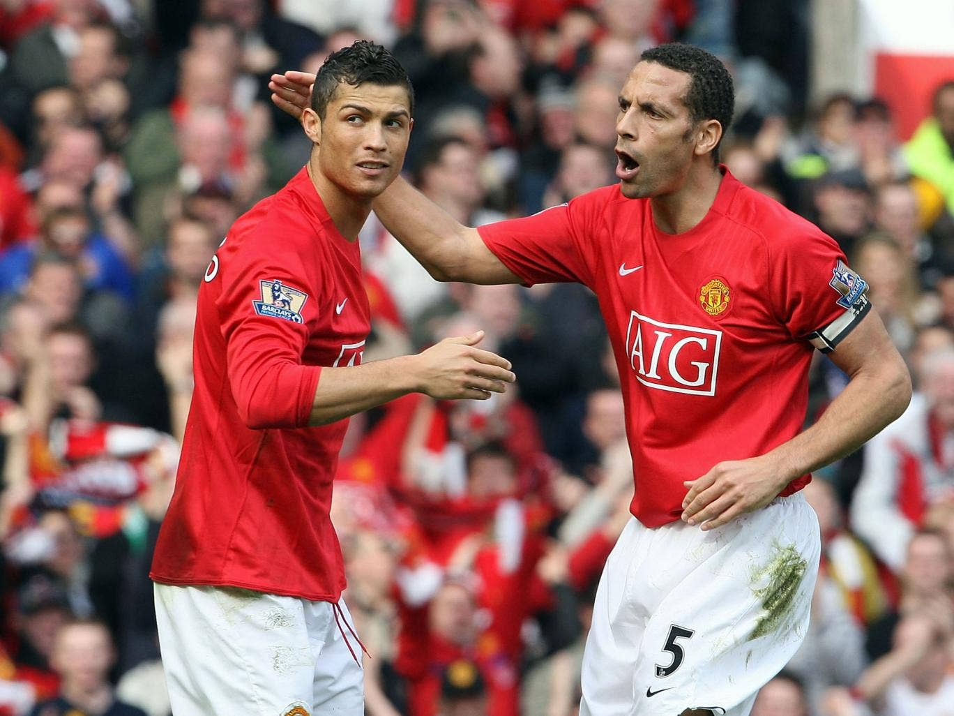 Rio Ferdinand (R) has admitted that he tried to persuade Cristiano Ronaldo (L) to return to Manchester United last summer