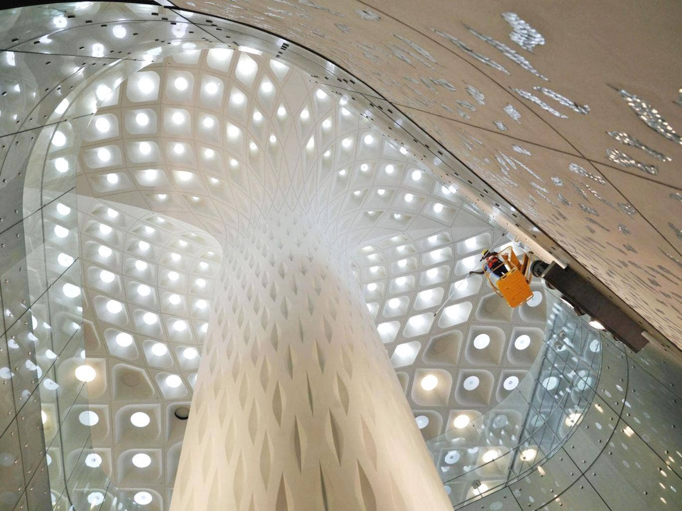 Indian workers clean a wall of the new airport terminal at the Chhatrapati Shivaji International Airport in Mumbai