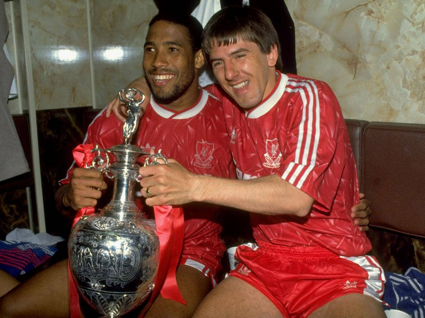 John Barnes (left) and Peter Beardsley celebrate Liverpool's last title – back in 1990