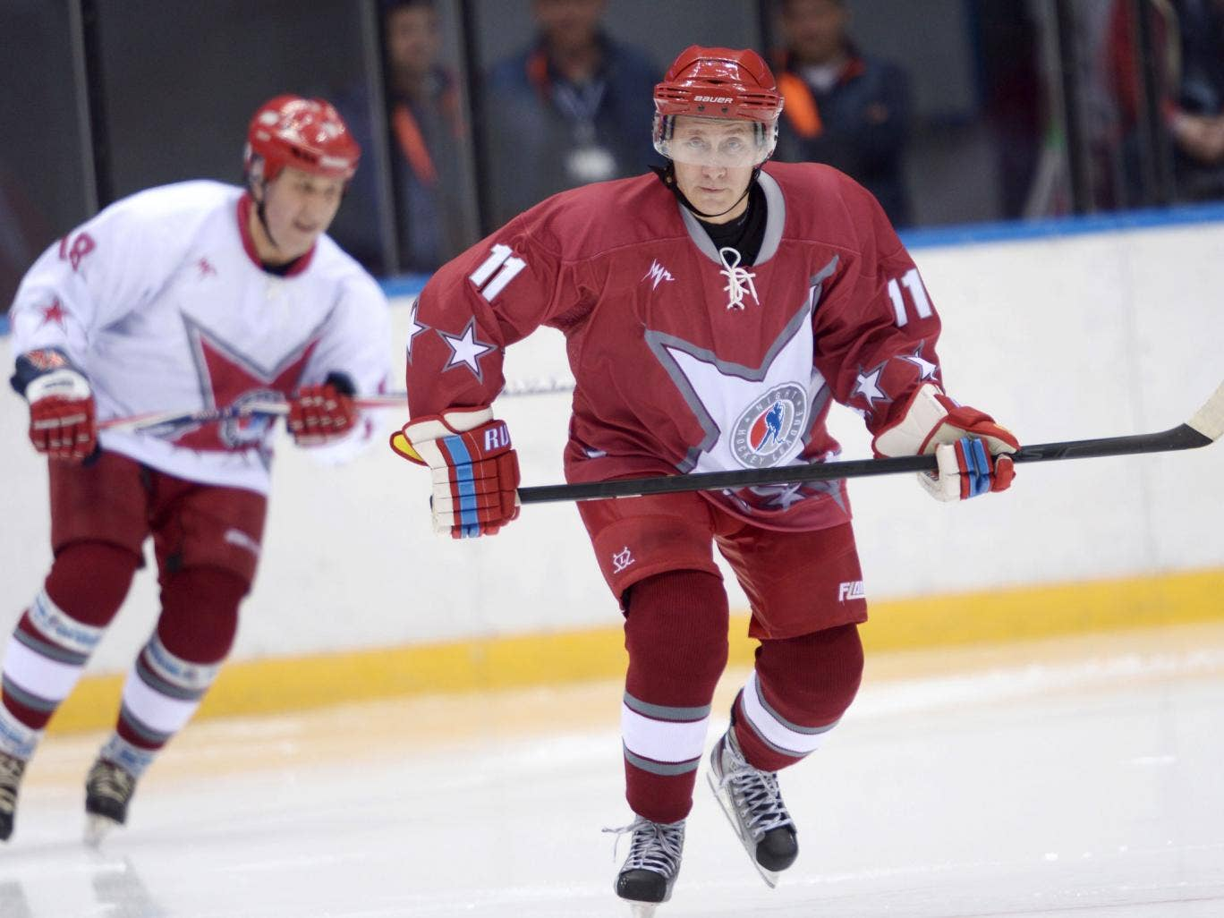 President Vladimir Putin, who has backed the £30bn Games, with the Russia ice hockey team in Sochi
