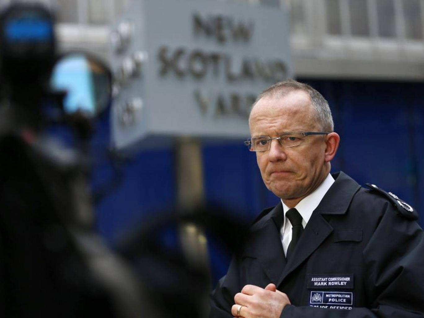 Metropolitan Police Assistant Commissioner Mark Rowley speaks to the media outside New Scotland Yard on Thursday