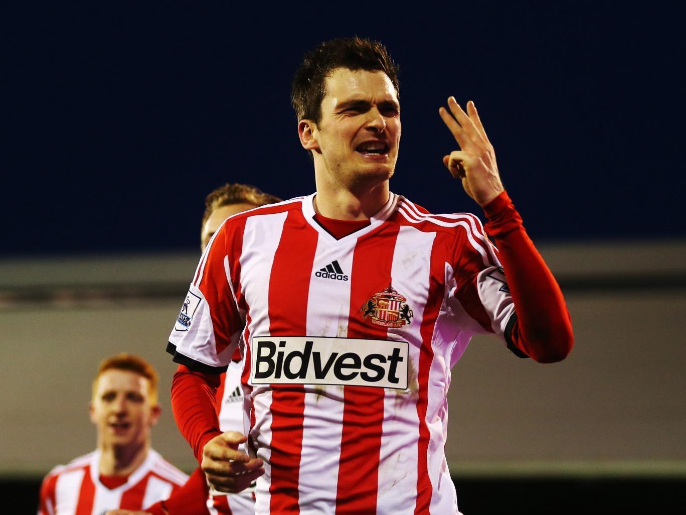 Adam Johnson celebrates his hat-trick against Fulham