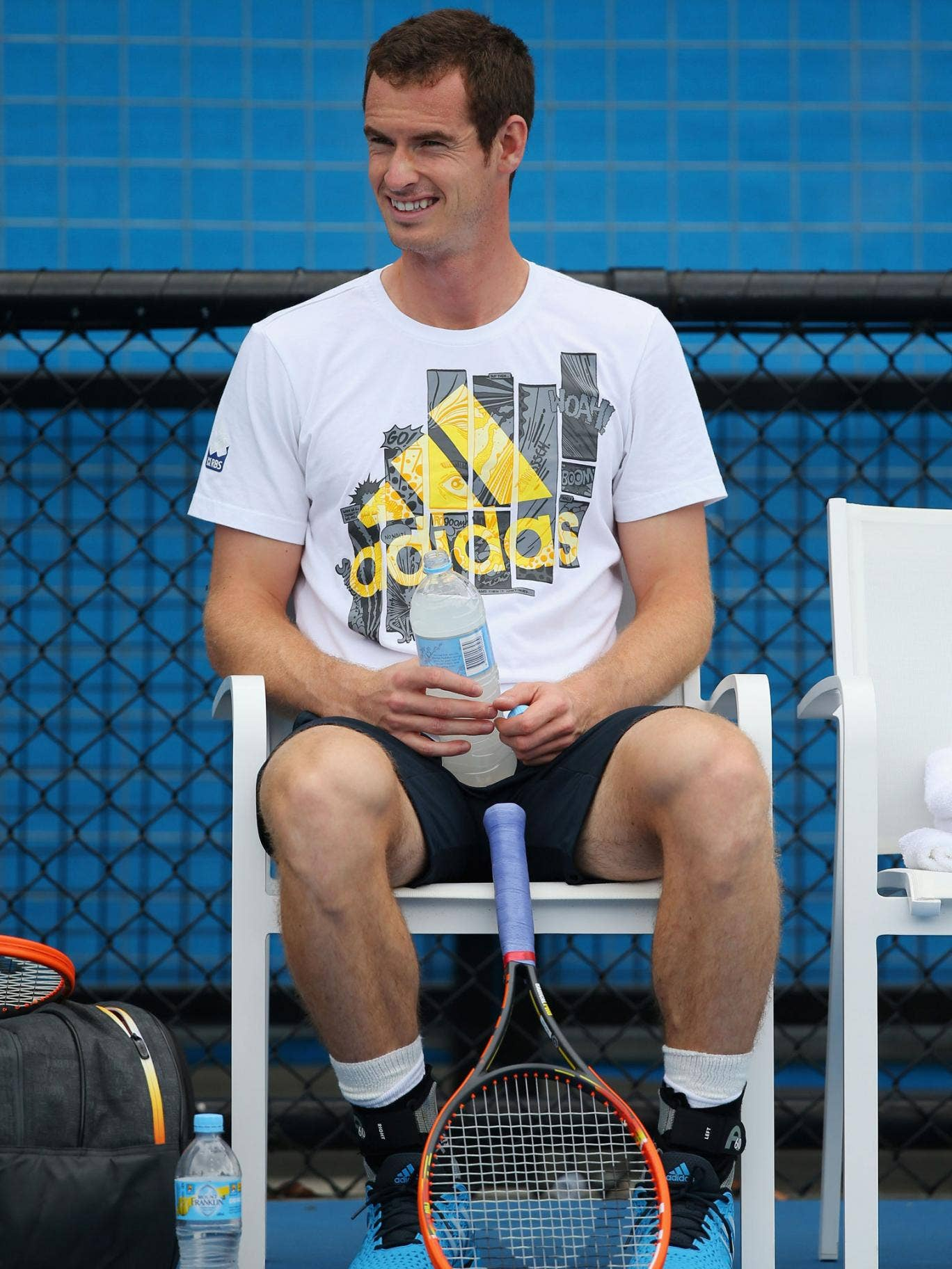 Andy Murray takes a much-needed drinks break during training at Melbourne Park
