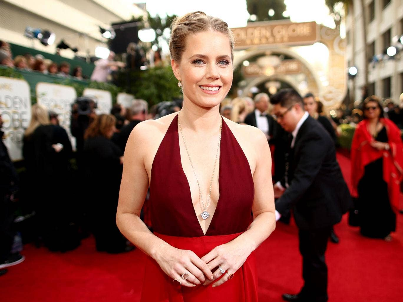 Actress Amy Adams arrives at the 71st Annual Golden Globe Awards