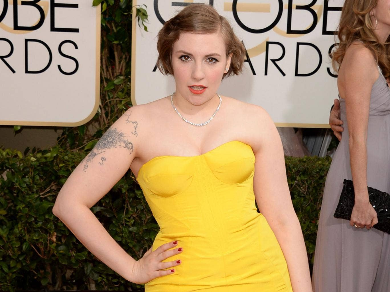 Actress Lena Dunham attends the 71st Annual Golden Globe Awards
