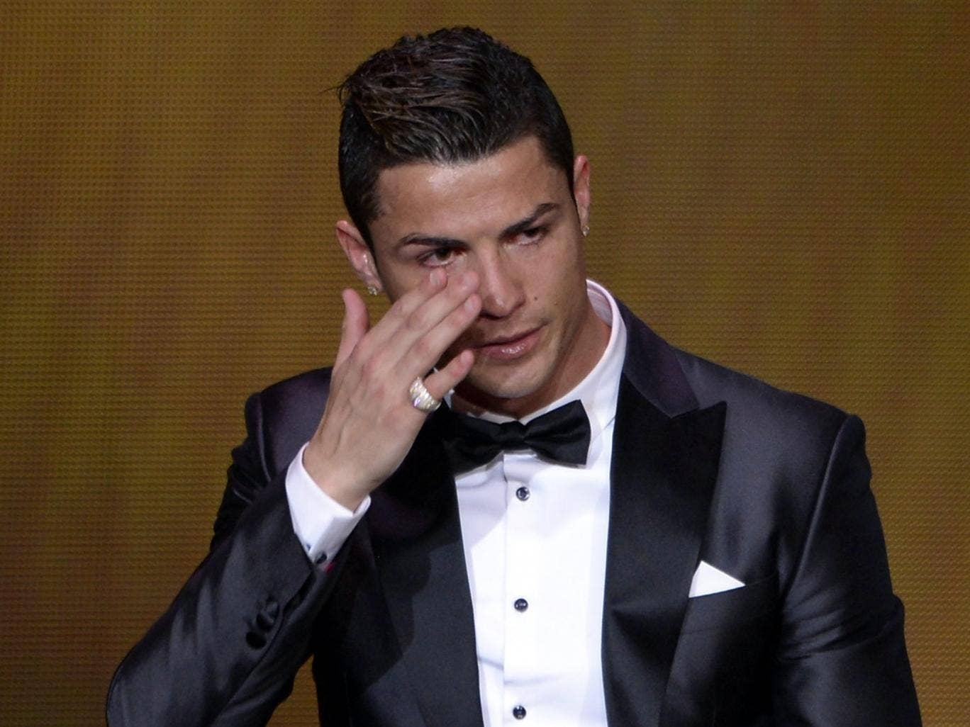 Cristiano Ronaldo fights back tears after winning the Fifa Ballon d'Or award