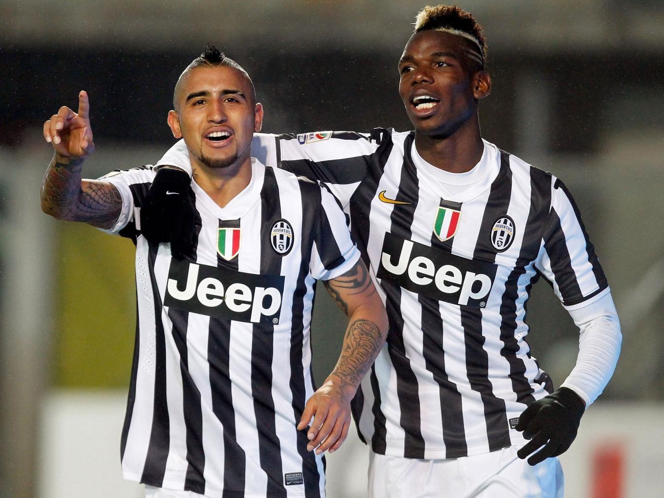 Arturo Vidal (L) and Paul Pogba of Juventus