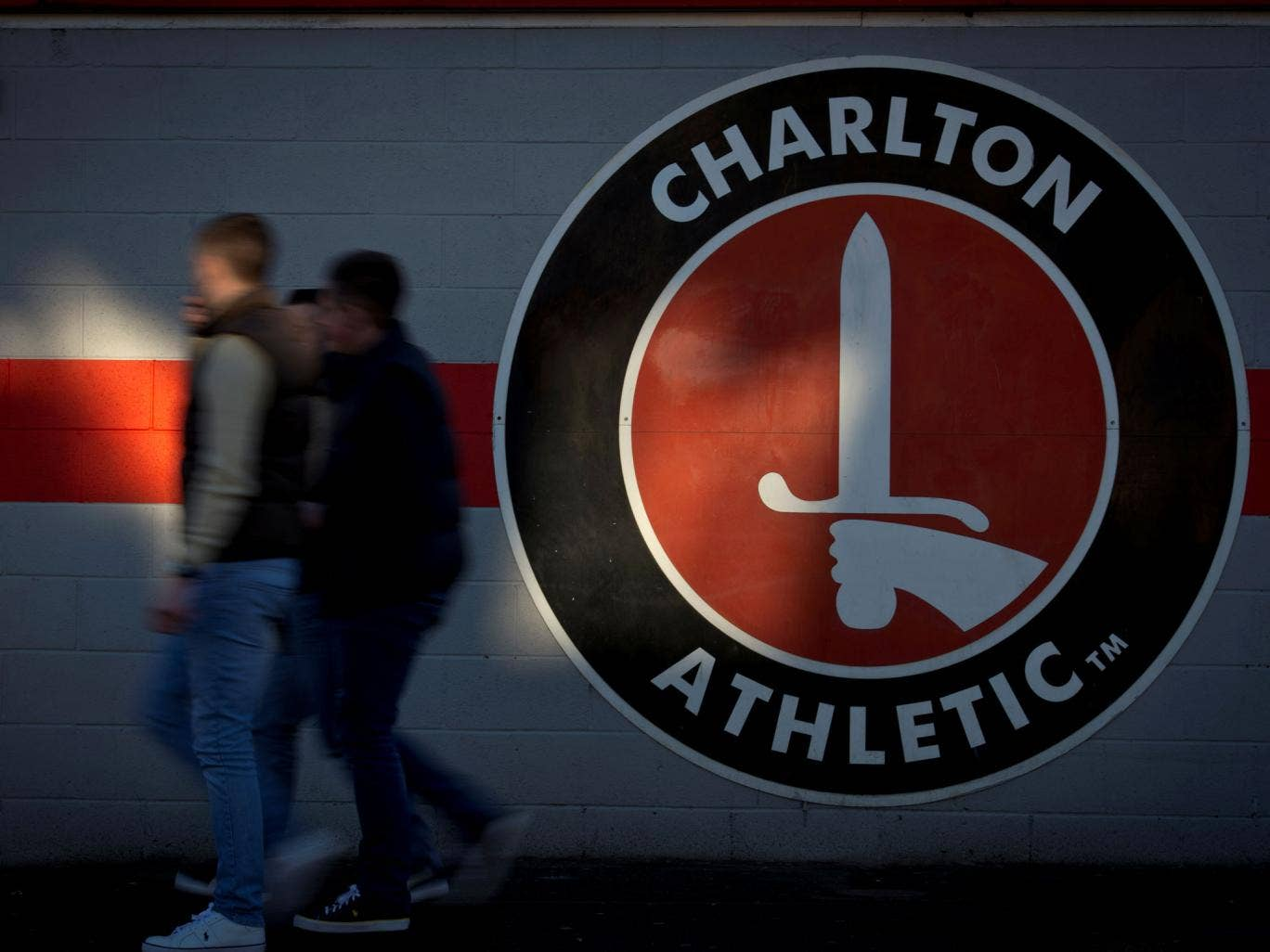 Fans arrive at Charlton Athletic's home ground The Valley