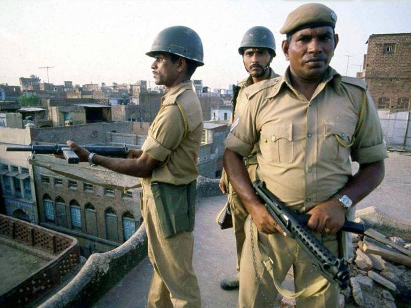 In this file photo from 6 June, 1984, Indian troops take up position on rooftops around the Golden Temple in Amritsar